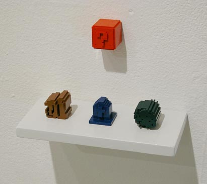 plastic 3d printed sculpture of super mario question block and zelda rock, tombstone, and bush from  nintendo
